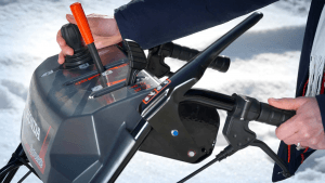 Electric Chute Joystick Control being used by a person on a Honda snowblower